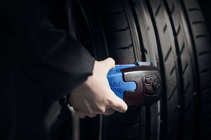 Treadreader Handheld on a tyre for wheel alignment check