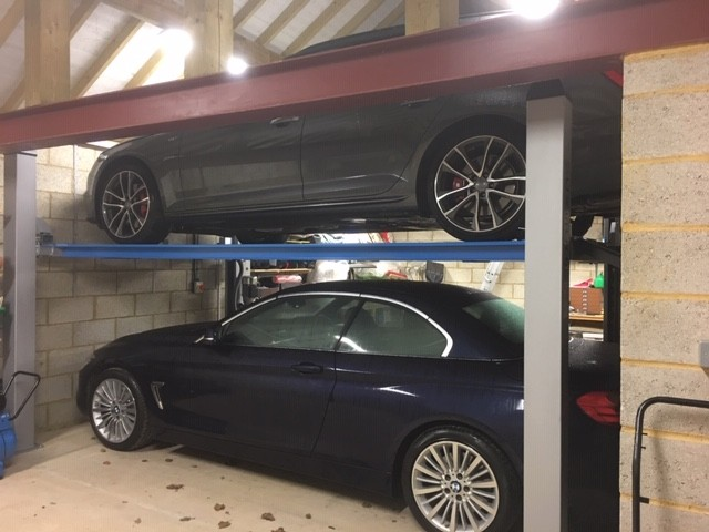 A fun one to finish! This Cascos C430 four post lift has been installed for storage purposes. The vehicle lift allows space for an extra vehicle and is able to fit in the tightest of spaces.