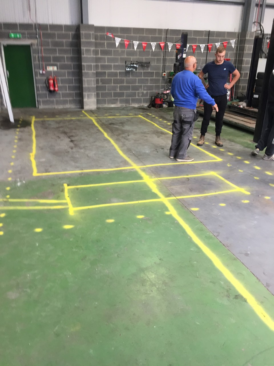 MARKING OUT THE AREA FOR EXCAVATION TO INSTALL A BRAND NEW MOT BAY AT FUSION AUTOS.