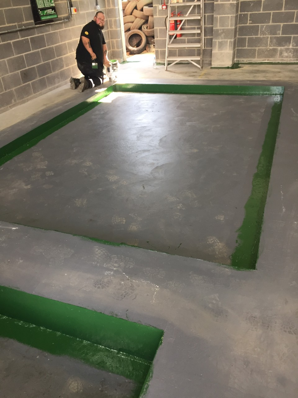 COMPLETED AND SET CONCRETE READY FOR THE INSTALLATION OF THE NEW MOT EQUIPMENT.