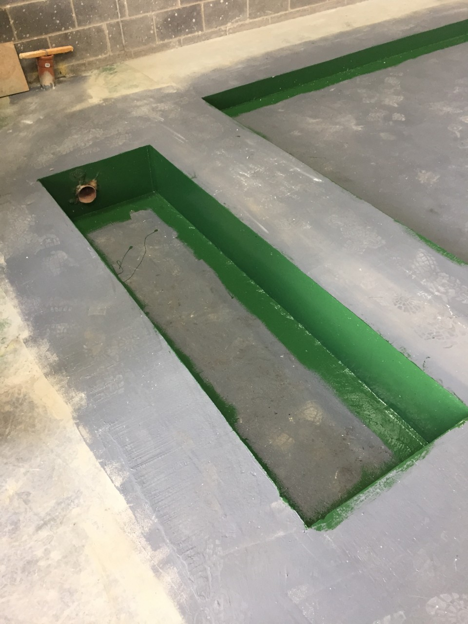 COMPLETED AND SET CONCRETE READY FOR THE INSTALLATION OF THE NEW BRAKE TESTING EQUIPMENT.