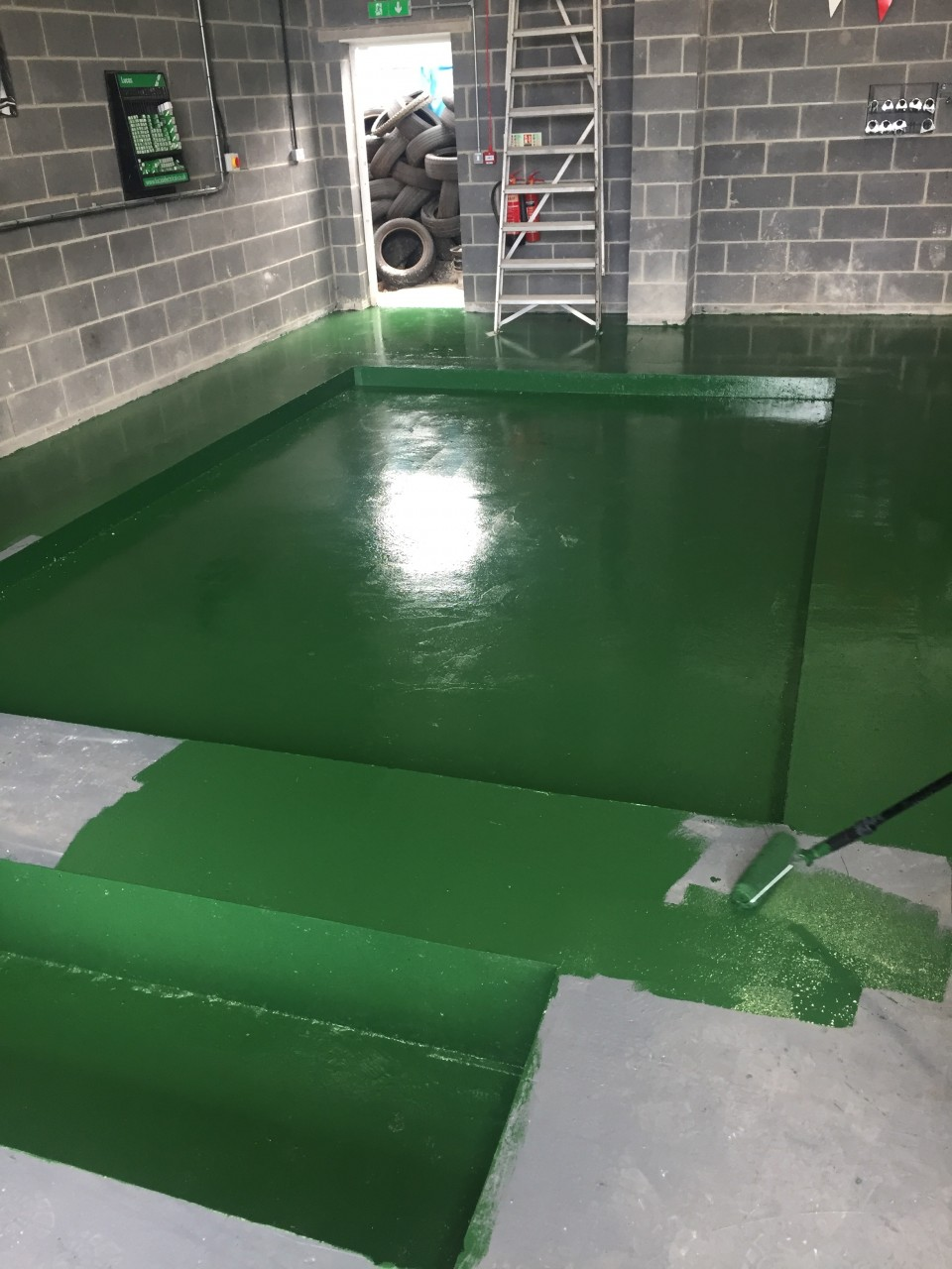 AESTHETICS ARE IMPORTANT TOO - THE FUSION AUTOS GREEN PAINT BEING PAINTED TO THE FLOOR.