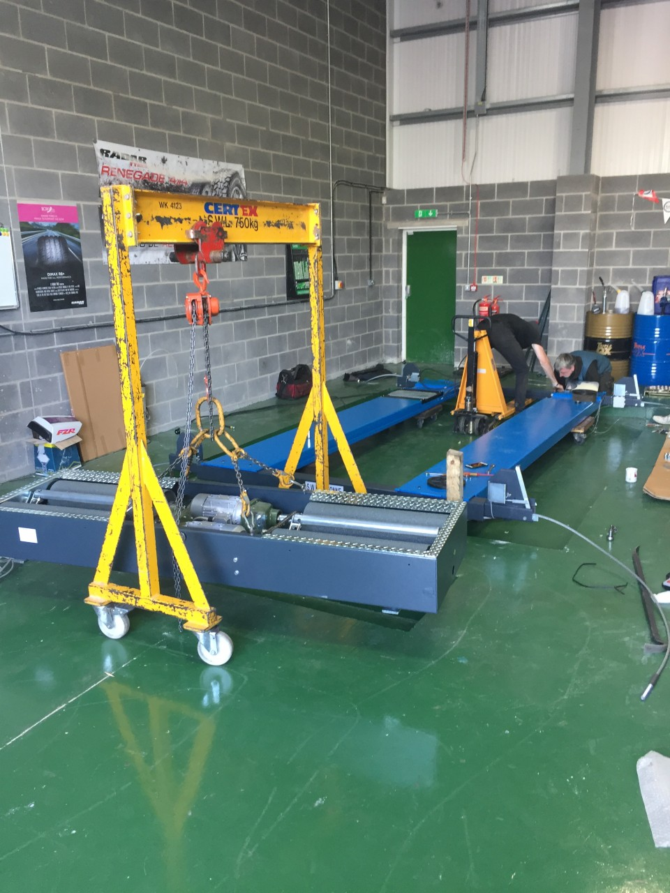 THE INSTALLED MOT RAMP AND THE BRAKE TESTERS LIFTED ON THE CRANE, READY FOR INSTALLATION.