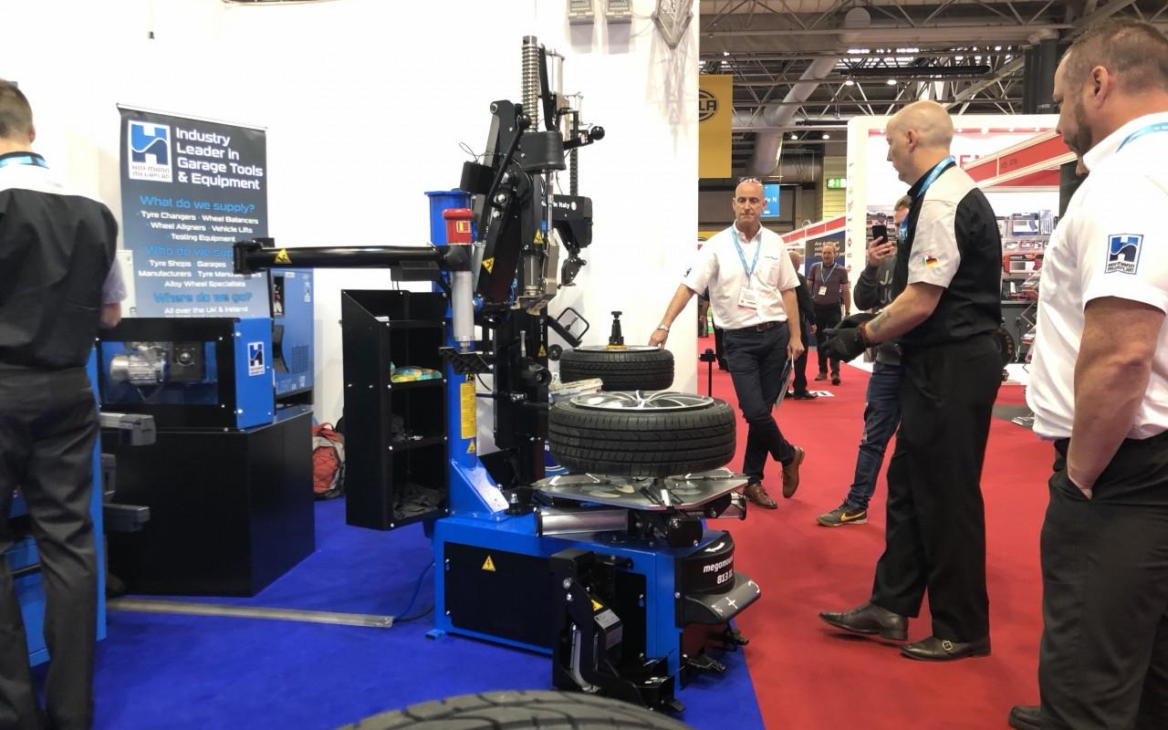 The team and delegates watch on as a Live Tyr Changer demo is completed at Automechanika 2018