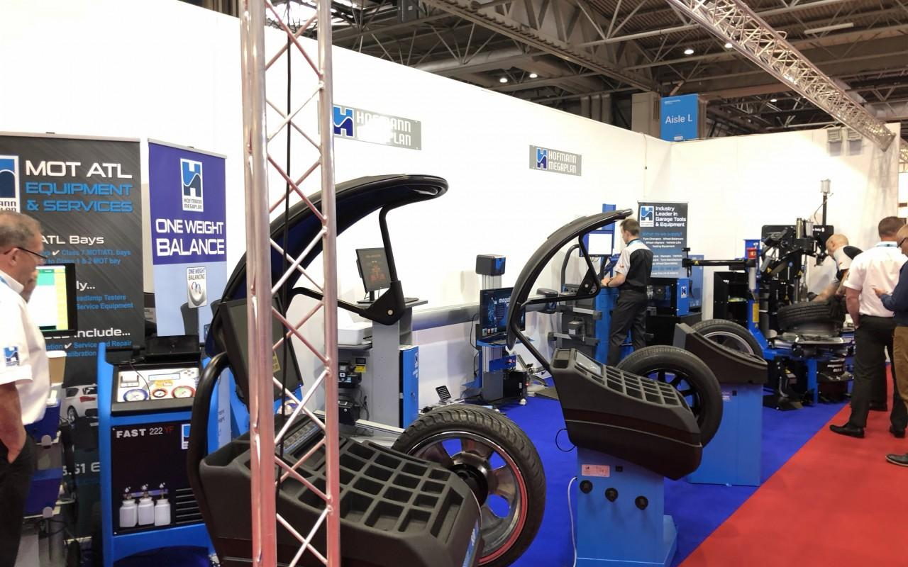Full stand shot including wheel balancers, tyre changers and alignment equipment